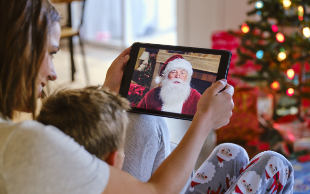 woman and child video chatting with santa